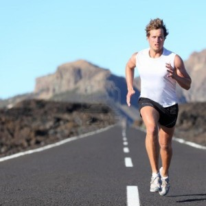 10473230-runner-running-for-marathon-on-road-in-beautiful-mountain-landscape-caucasian-man-jogging-outdoors-i
