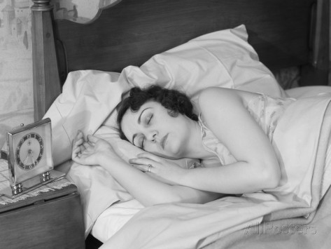 h-armstrong-roberts-brunette-woman-asleep-in-bed-alarm-clock-on-night-stand-sleeping